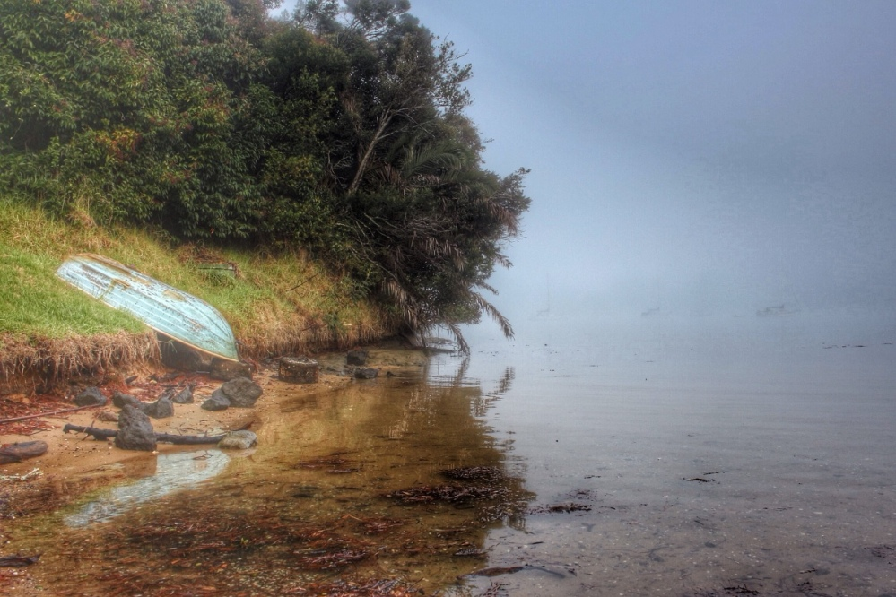 Upturned dinghy reflected in water, misty morning, Greenhithe, Auckland, NZ. Image: Su Leslie, 2016